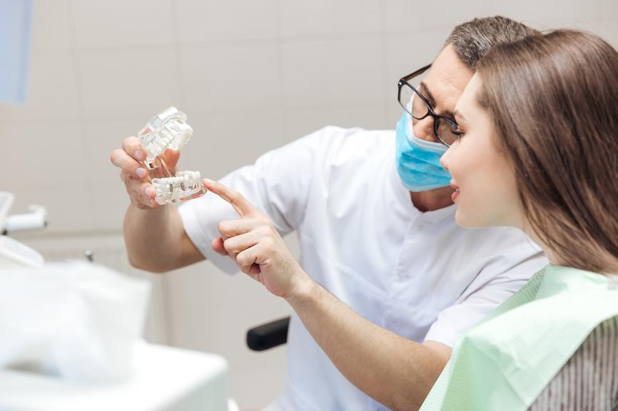 Dentist Showing Dentures